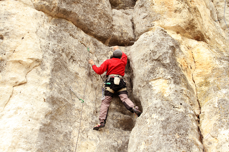 man climbing: Climbing. Stock Photo