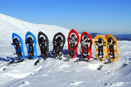 snow break: Snowshoeing. Snowshoes in the snow. Photo from Quebec, Canada.