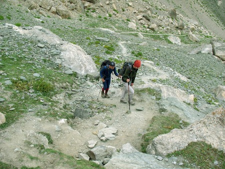 active life: Hiker trekking in the mountains. Sport and active life.