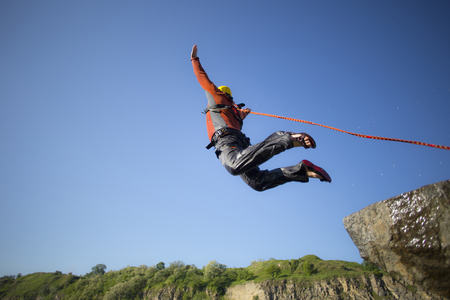 caida libre: A man jumps from a cliff into the abyss. Foto de archivo