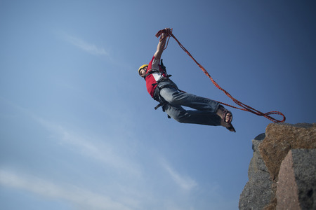Jump off a cliff into the abyss. Stock Photo