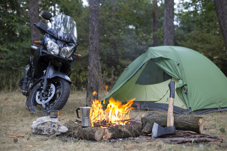 Camping in the woods bike standing next to the tent. Stock Photo