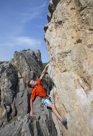 rappeller: Rock climber to climb the wall. Stock Photo