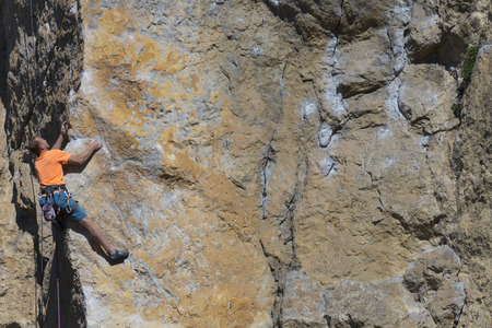 rappel: Rock climber to climb the wall. Stock Photo