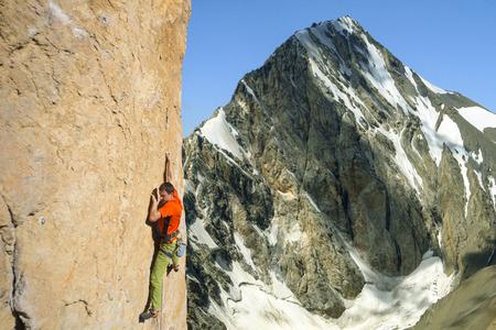 Rock climber to climb the wall. Stock Photo