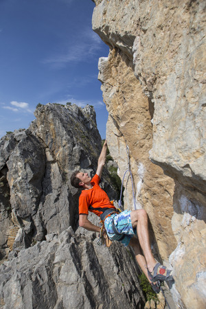 vigor: Rock climber to climb the wall. Stock Photo