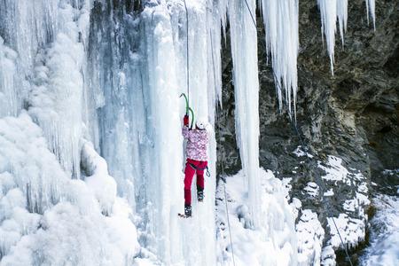daredevil: Ice climbing the North Caucasus, man climbing frozen waterfall.