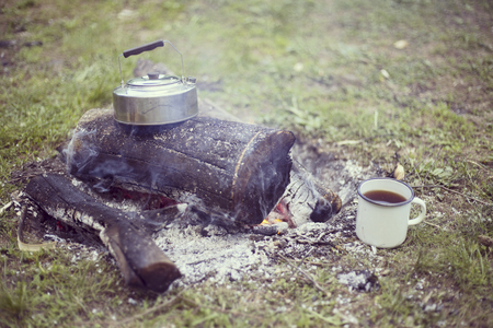 Cooking breakfast on a campfire at a summer camp. Stock Photo
