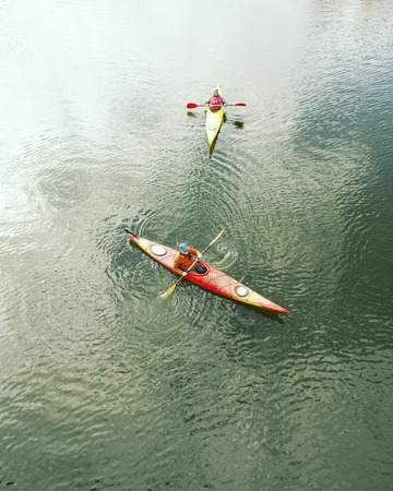 paddles: A couple kayaking on Crescent Lake in Olympic Park, USA Stock Photo