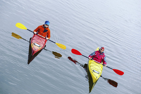 A couple kayaking on Crescent Lake in Olympic Park, USA Stock Photo