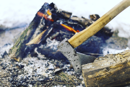 wood burner: Cooking breakfast on a fire in a tent camp.