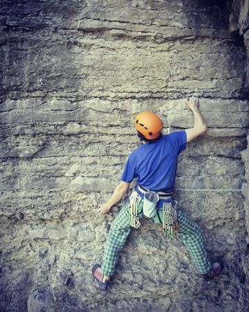 joshua tree national park: Rock climber reaching for his next hand hold, Joshua Tree National Park.