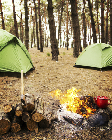 Camping in the forest. Preparation of breakfast at the stake. 版權商用圖片
