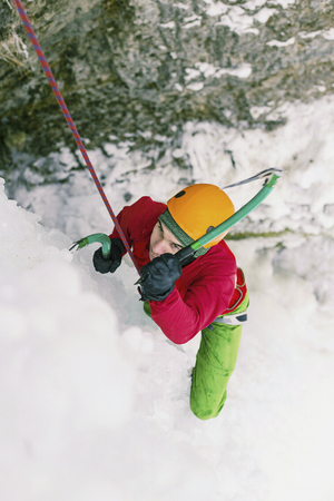 crampon: Ice climbing in the mountains along the waterfall. Stock Photo