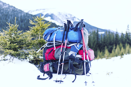 Winter hiking in the mountains on snowshoes with a backpack and tent. Stock Photo
