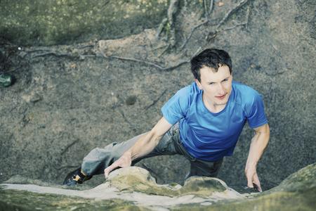 Climber to climb a big wall. Stock Photo