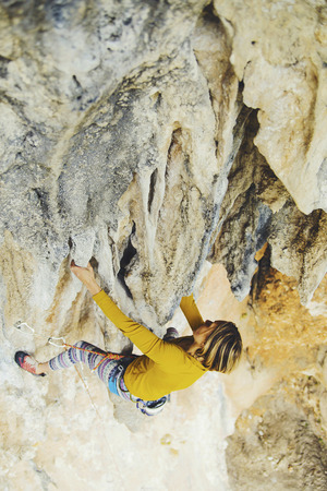 Rock-climbing in Turkey. The girl climbs on the route. Photo from the top. Stock fotó