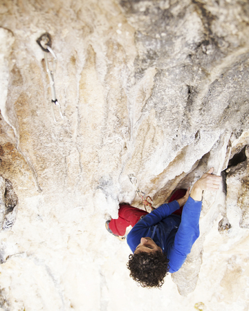 Rock-climbing in Turkey. The climber climbs on the route. Photo from the top. 스톡 콘텐츠
