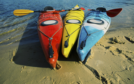 Kayaking on the Lake Concept Photo. Sport Kayak on the Rocky Lake Shore. Close Up Photo.
