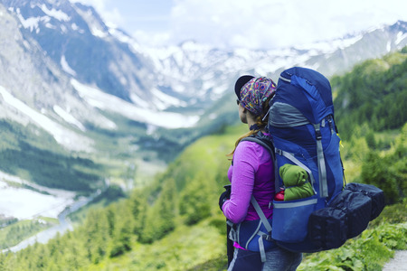 Campaign around Mont Blanc. The girl is walking along the trail with a backpack. Stock Photo