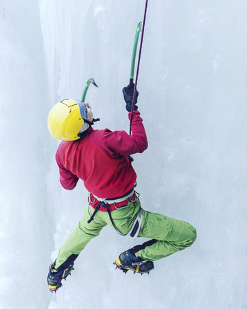 Ice climbing on a frozen waterfall.