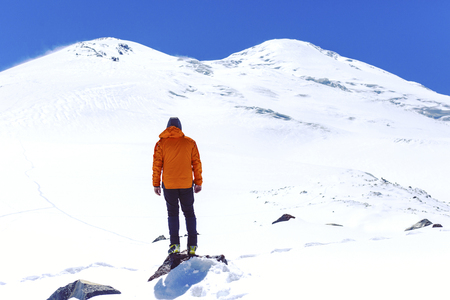 A man makes the approach under the mountain Elbrus. North Caucasus. Russia