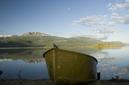 green boat: green boat on a mooring in the taiga