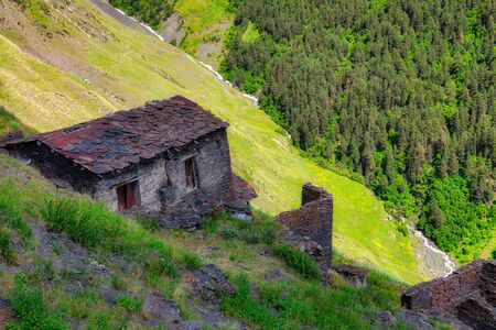 Ancient national stone house in the Caucasus Mountains, Georgia.