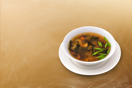 mushroom soup: Mushroom soup with herbs on a beautiful brown background Stock Photo