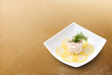 quid: The Seafood salad on a brown background Stock Photo