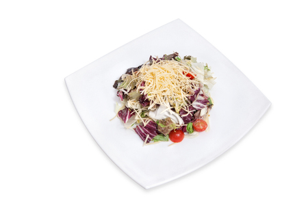 Salad with vegetables, cheese and meat decorated cherry tomatoes Stock Photo