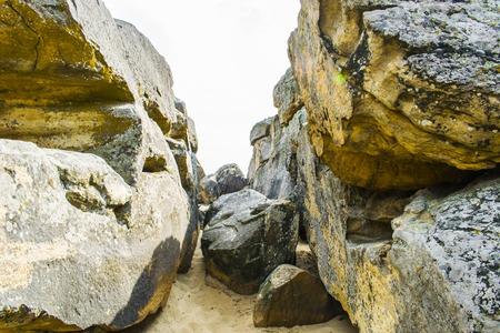 Passage between large stones.