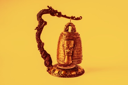 Chinese temple bell small, orange color gleams