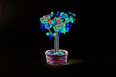 reiki: Money tree on a dark background. The tree is blue, blue