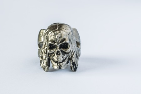 Silver skull ring on white background. The skull looks and smiles Stock Photo