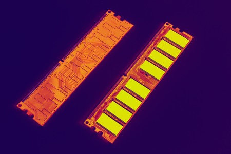 Memory module DDR RAM orange yellow, on a purple background Stock Photo