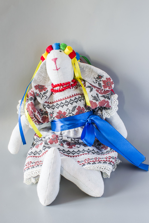 puppets: A doll in national Ukrainian in a suit with ribbons. Against a light background