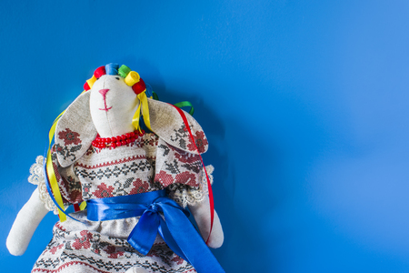 muñecas rusas: The doll is a guard in a national costume with ribbons. On a blue background