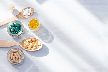 Vitamins, supplements, healthy life concept. Flat lay, copy space. Stock Photo