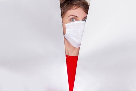 Portrait of a girl on a white isolated background, face covered with a medical mask, banner for text. Health, awareness, and timeliness. Healthy lifestyle. No viruses.