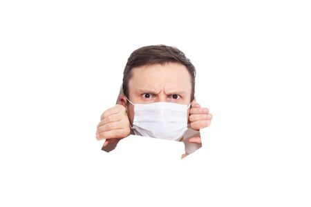 Portrait of a man on a white isolated background, face covered with a medical mask, banner for text. Health, awareness, and timeliness. Healthy lifestyle. No viruses. Fear of getting sick