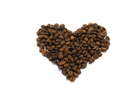 Heart made of roasted coffee beans on white backgroud Stock Photo