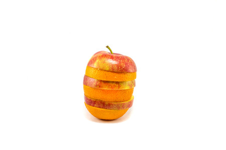 Mix of fresh orange and apple on a white background Stock Photo