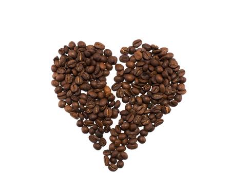Brocken heart made of coffee beans on white backgroud Stock Photo