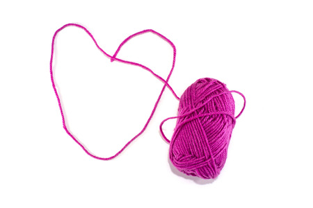 Big heart made of purple skein of thread, isolated