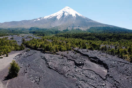 Volcano Osorno aerial view from drone. Dry arid climate and traces on volcanic sand. Clear blue sky. Puerto Varas, Osorno.