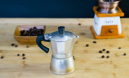 Old Italian Moka coffee maker, manual coffee grinder