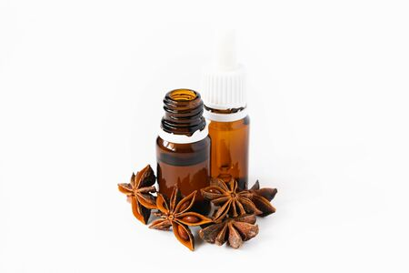 Aniseed oil with nuts on a white background