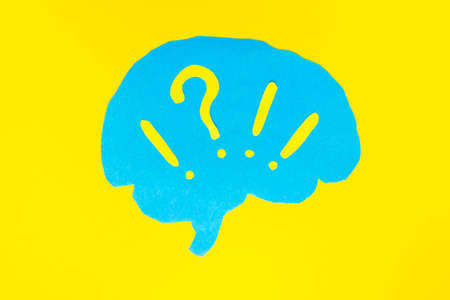 problem concept, blue brain layout with question and exclamation marks on yellow background