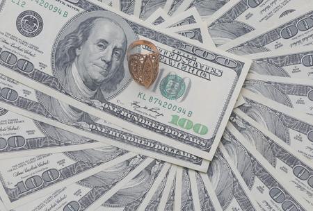 signet: gold signet on a pile of U.S. dollars